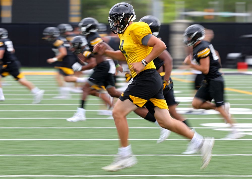 Iowa Hawkeyes quarterback Nate Stanley (4) runs with his teammates as he warms up during Fall Camp Practice No. 15 at the Hansen Football Performance Center in Iowa City on Monday, Aug 19, 2019. (Stephen Mally/hawkeyesports.com)