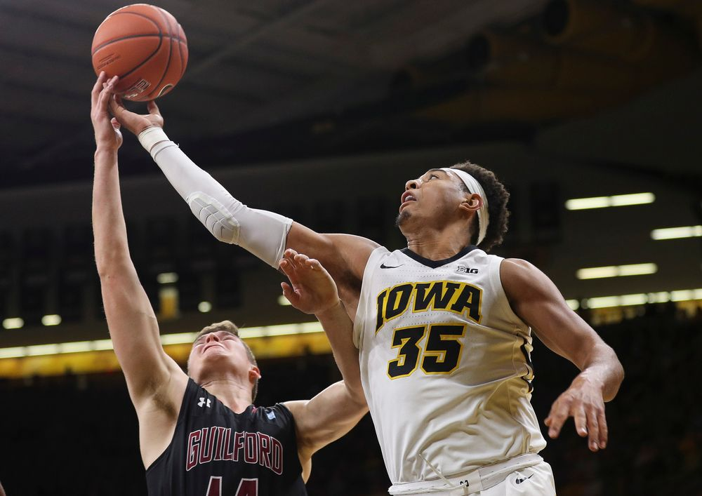 Iowa Hawkeyes forward Cordell Pemsl (35) goes up for a rebound during a game against Guilford College at Carver-Hawkeye Arena on November 4, 2018. (Tork Mason/hawkeyesports.com)