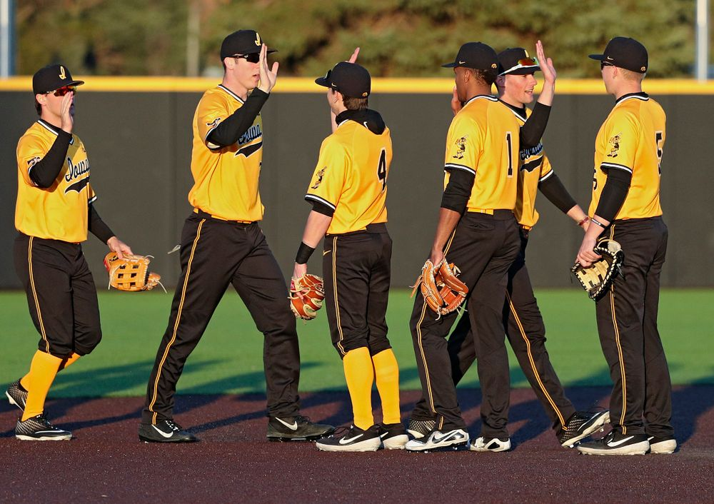 The Iowa Hawkeyes celebrate after winning their game at Duane Banks Field in Iowa City on Tuesday, Apr. 2, 2019. (Stephen Mally/hawkeyesports.com)