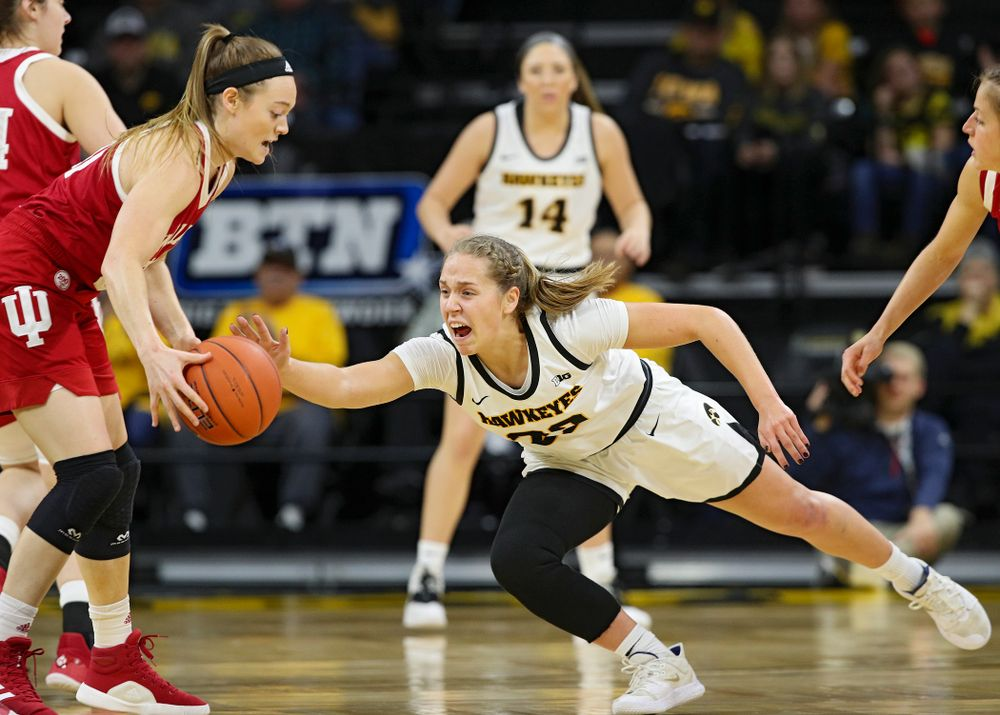 Iowa Hawkeyes guard Kathleen Doyle (22) tries to knock the ball away from Indiana Hoosiers forward Brenna Wise (50) during the first quarter of their game at Carver-Hawkeye Arena in Iowa City on Sunday, January 12, 2020. (Stephen Mally/hawkeyesports.com)