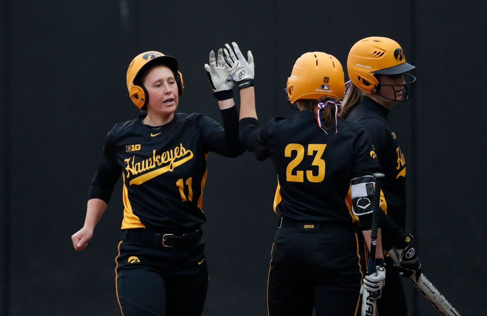 Iowa Hawkeyes first baseman Mallory Kilian (11) and infielder Alex Rath (23) against the Minnesota Golden Gophers Friday, April 13, 2018 at Bob Pearl Field. (Brian Ray/hawkeyesports.com)