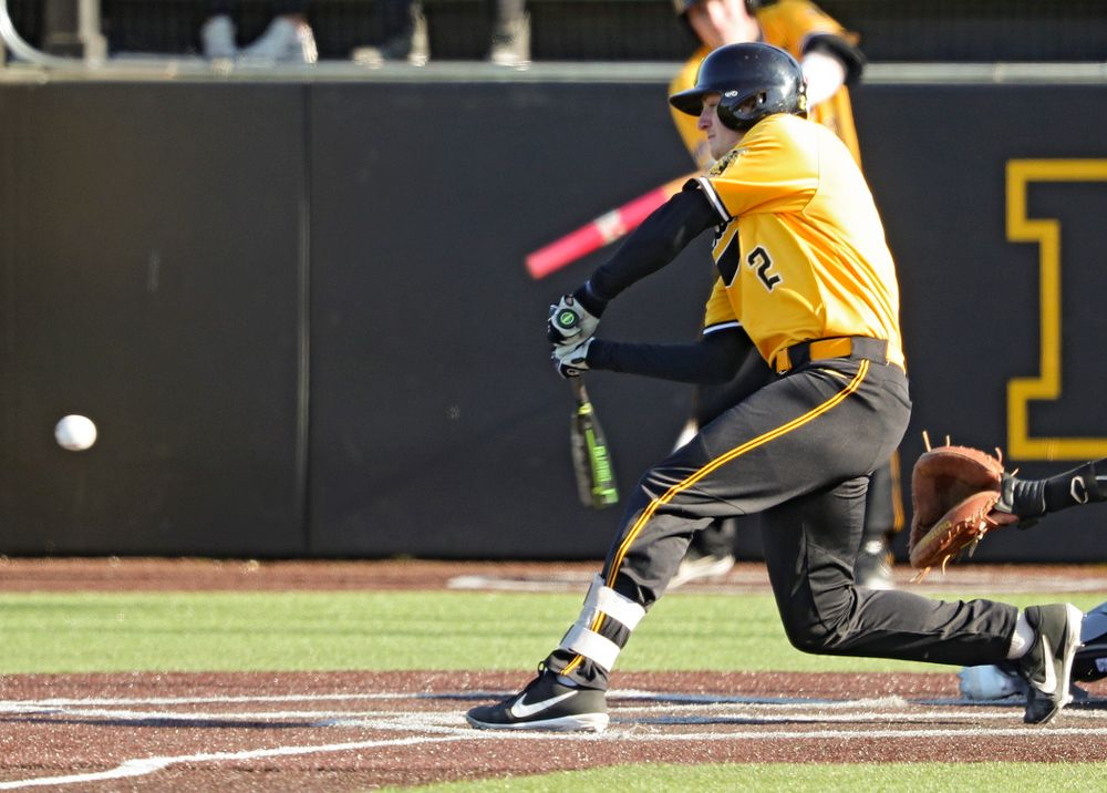 Iowa Hawkeyes shortstop Brendan Sher (2) drives a pitch for a hit during the fourth inning of their game at Duane Banks Field in Iowa City on Tuesday, Apr. 2, 2019. (Stephen Mally/hawkeyesports.com)