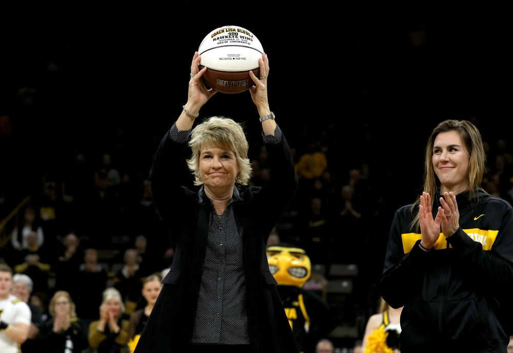 Henry B. and Patricia B. Tippie Director of Athletics Chair Gary Barta presents Iowa Hawkeyes head coach Lisa Bluder with a ceremonial ball commemorating her 400th Hawkeye win before their game against Clemson Wednesday, December 4, 2019 at Carver-Hawkeye Arena. (Brian Ray/hawkeyesports.com)