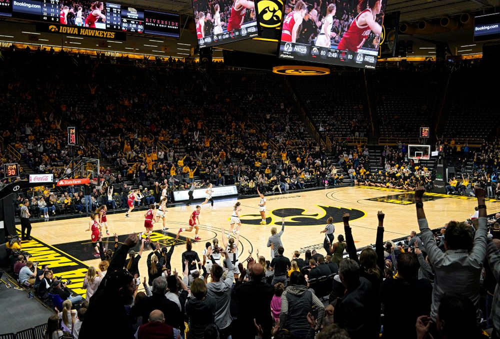 The crowd reacts after Iowa Hawkeyes guard Makenzie Meyer (3) made a 3-pointer during the second overtime period of their game at Carver-Hawkeye Arena in Iowa City on Sunday, January 12, 2020. (Stephen Mally/hawkeyesports.com)