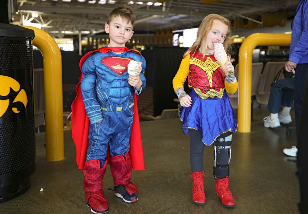 Two young fans eat ice cream cones on Superhero and Princess Day before the meet at Carver-Hawkeye Arena in Iowa City on Sunday, March 8, 2020. (Stephen Mally/hawkeyesports.com)