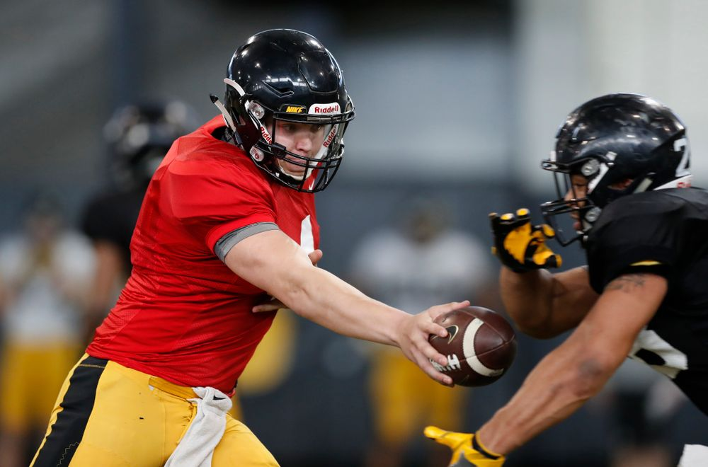 Iowa Hawkeyes quarterback Nathan Stanley (4) and running back Toren Young (28) Wednesday, April 4, 2018 at the Hansen Football Performance Center. (Brian Ray/hawkeyesports.com)