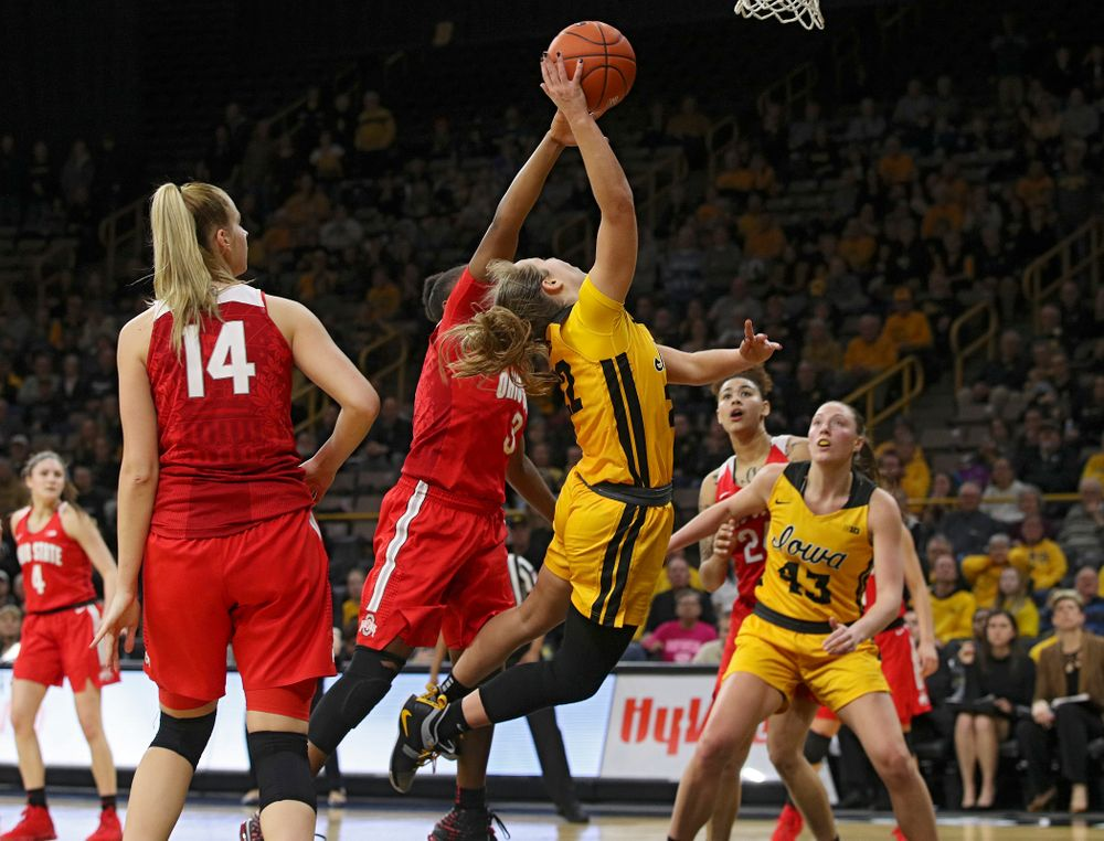 Iowa Hawkeyes guard Kathleen Doyle (22) scores a basket while being fouled during the fourth quarter of their game at Carver-Hawkeye Arena in Iowa City on Thursday, January 23, 2020. (Stephen Mally/hawkeyesports.com)
