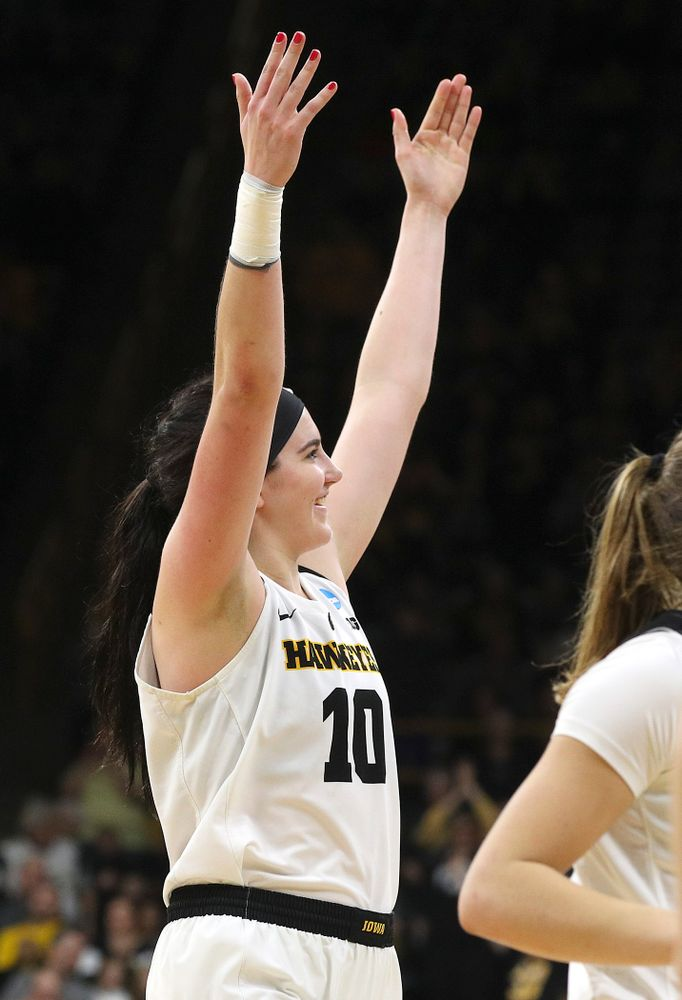 Iowa Hawkeyes center Megan Gustafson (10) pumps up the crowd as she walks back to her bench for a timeout during the fourth quarter of their second round game in the 2019 NCAA Women's Basketball Tournament at Carver Hawkeye Arena in Iowa City on Sunday, Mar. 24, 2019. (Stephen Mally for hawkeyesports.com)
