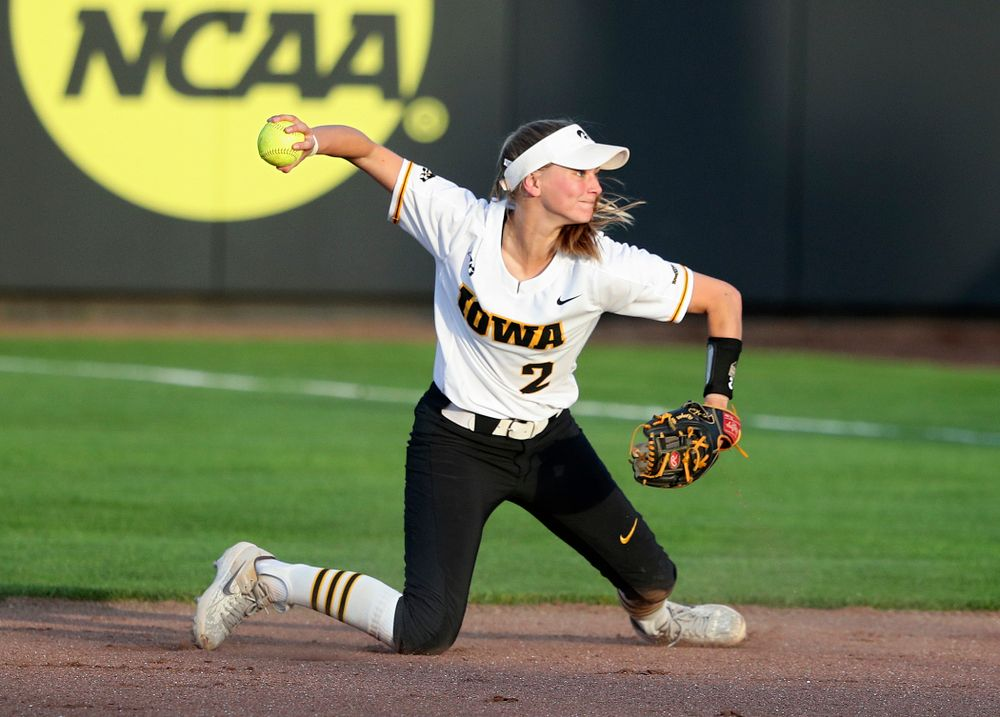 Iowa second baseman Aralee Bogar (2) throws to first base for an out during the seventh inning of their game against Ohio State at Pearl Field in Iowa City on Friday, May. 3, 2019. (Stephen Mally/hawkeyesports.com)