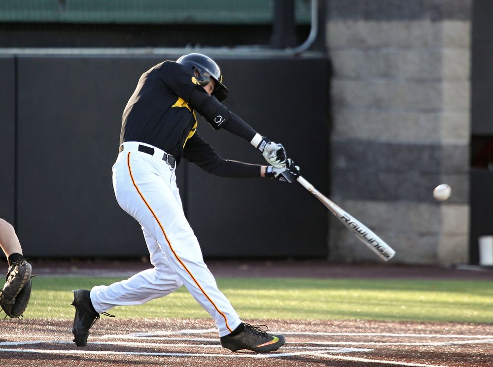 Iowa outfielder Ben Norman (9) drives a pitch for a hit during the first inning of their game at Duane Banks Field in Iowa City on Tuesday, March 3, 2020. (Stephen Mally/hawkeyesports.com)