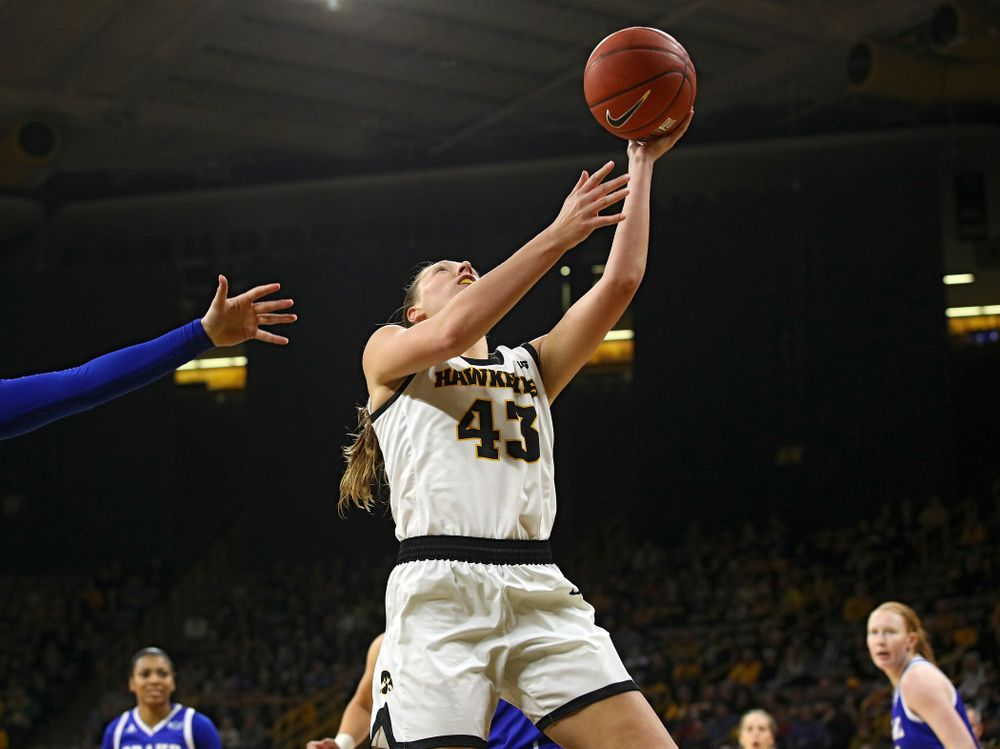 Iowa Hawkeyes forward Amanda Ollinger (43) makes a basket during the first quarter of their game at Carver-Hawkeye Arena in Iowa City on Saturday, December 21, 2019. (Stephen Mally/hawkeyesports.com)