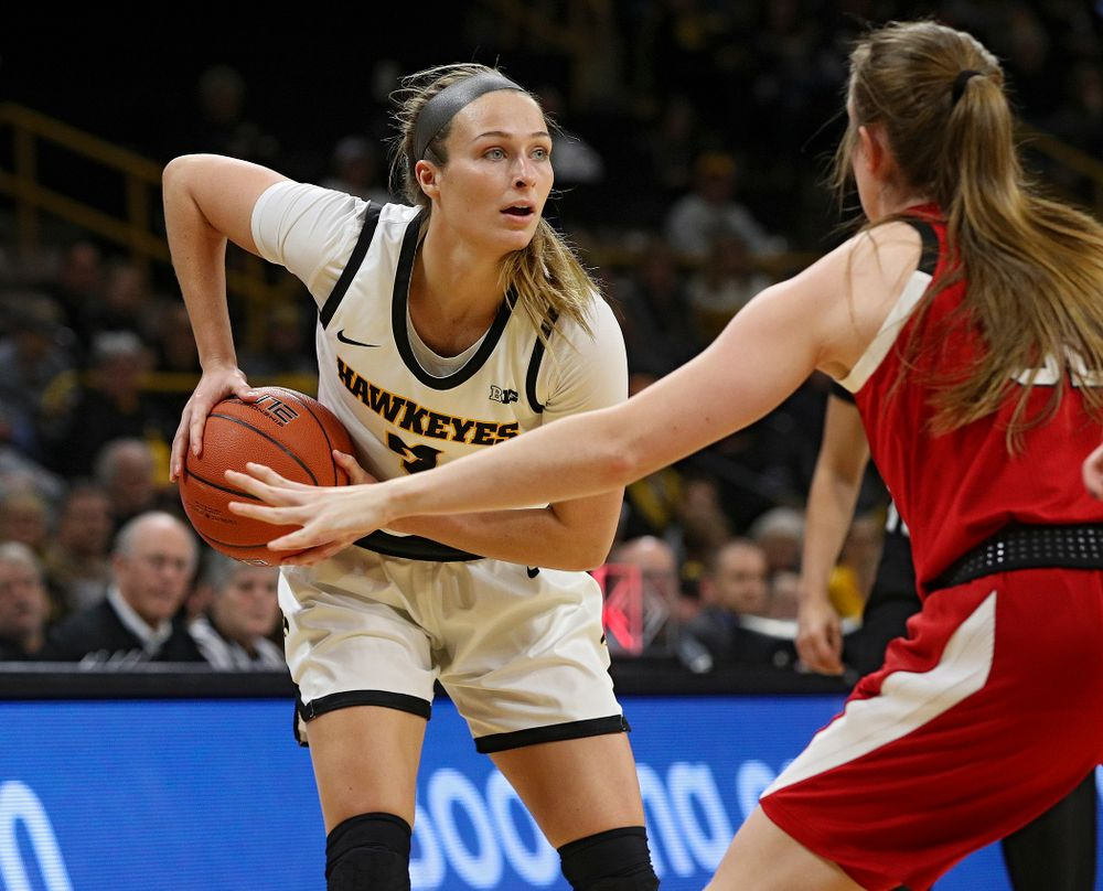 Iowa Hawkeyes guard Makenzie Meyer (3) looks to pass during the first quarter of the game at Carver-Hawkeye Arena in Iowa City on Thursday, February 6, 2020. (Stephen Mally/hawkeyesports.com)