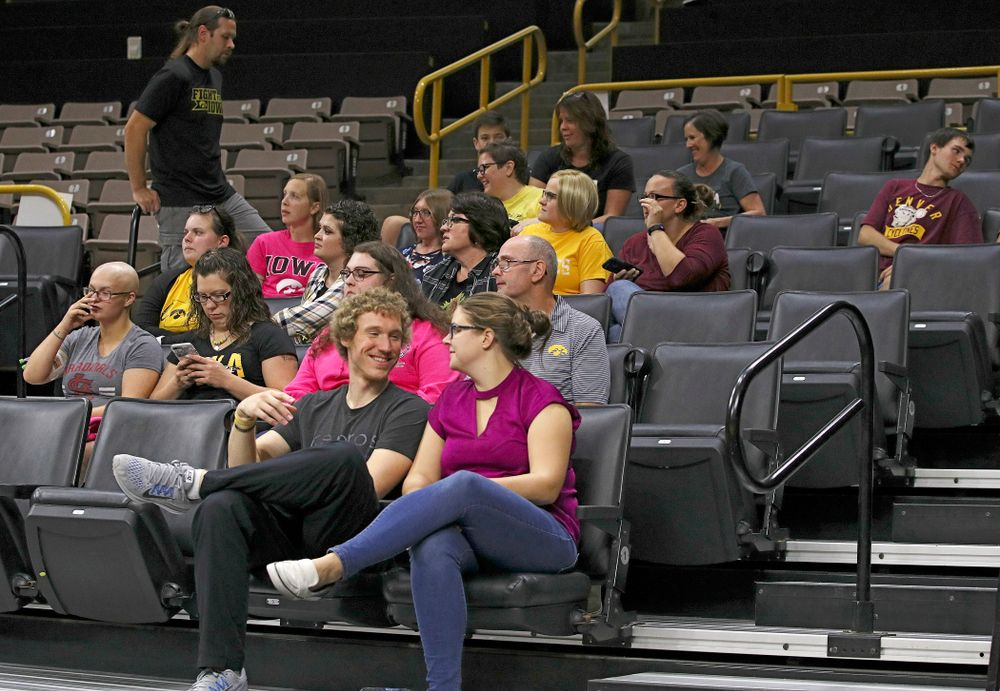 Visitors from the University of Iowa Hospitals and Clinics Adolescent and Young Adult (AYA) Cancer Program watch practice at Carver-Hawkeye Arena in Iowa City on Monday, Sep 30, 2019. (Stephen Mally/hawkeyesports.com)