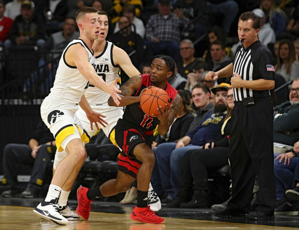 Iowa Hawkeyes guard Joe Wieskamp (10) and guard Connor McCaffery (30) pressure SIU Edwardsville Cougars guard Tyresse Williford (11) during the first half of their game at Carver-Hawkeye Arena in Iowa City on Friday, Nov 8, 2019. (Stephen Mally/hawkeyesports.com)