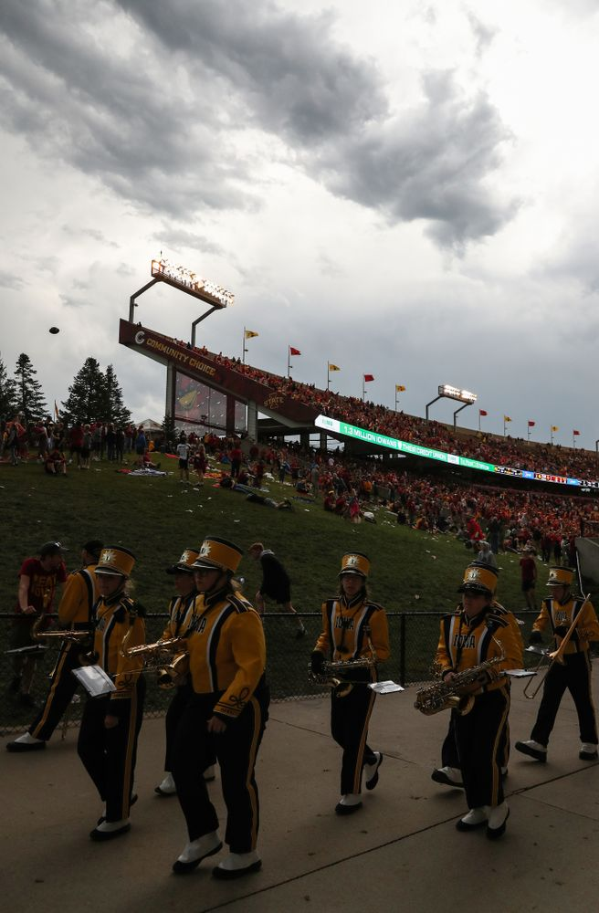 The Hawkeye Marching Band evacuates the field during a weather delay against the Iowa State Cyclones Saturday, September 14, 2019 at Jack Trice Stadium in Ames, Iowa. (Brian Ray/hawkeyesports.com)