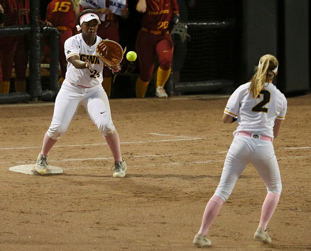 Iowa second baseman Aralee Bogar (2) throws to first baseman DoniRae Mayhew (24) for an out during the sixth inning of their game against Iowa State at Pearl Field in Iowa City on Tuesday, Apr. 9, 2019. (Stephen Mally/hawkeyesports.com)