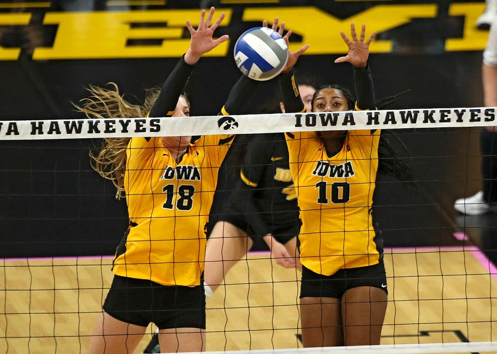Iowa's Hannah Clayton (18) and Griere Hughes (10) get a block during their match at Carver-Hawkeye Arena in Iowa City on Sunday, Oct 20, 2019. (Stephen Mally/hawkeyesports.com)