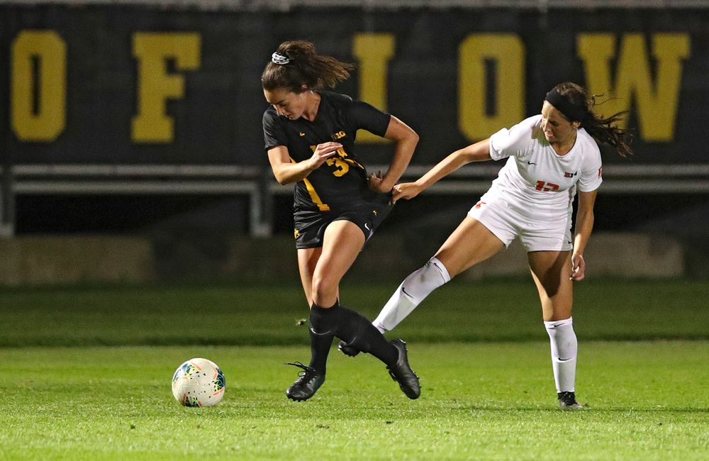 Iowa forward Devin Burns (30) tries to pull away from a defender during the first half of their match against Illinois at the Iowa Soccer Complex in Iowa City on Thursday, Sep 26, 2019. (Stephen Mally/hawkeyesports.com)