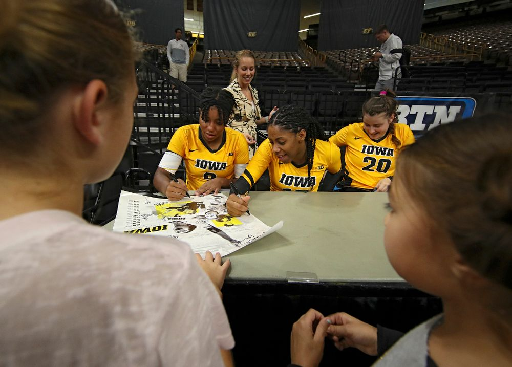 Iowa's Amiya Jones (9), Griere Hughes (10), and Edina Schmidt (20) sign autographs after their match at Carver-Hawkeye Arena in Iowa City on Sunday, Oct 20, 2019. (Stephen Mally/hawkeyesports.com)