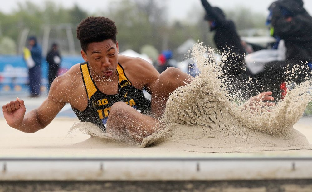 Iowa's James Carter jumps in the men's long jump event during the third day of the Drake Relays at Drake Stadium in Des Moines on Saturday, Apr. 27, 2019. (Stephen Mally/hawkeyesports.com)