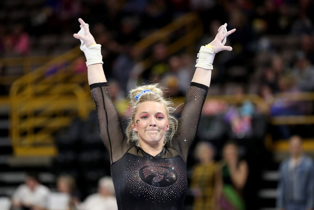 Iowa's Elinor Rogers competes on the bars against Michigan Friday, February 14, 2020 at Carver-Hawkeye Arena. (Brian Ray/hawkeyesports.com)