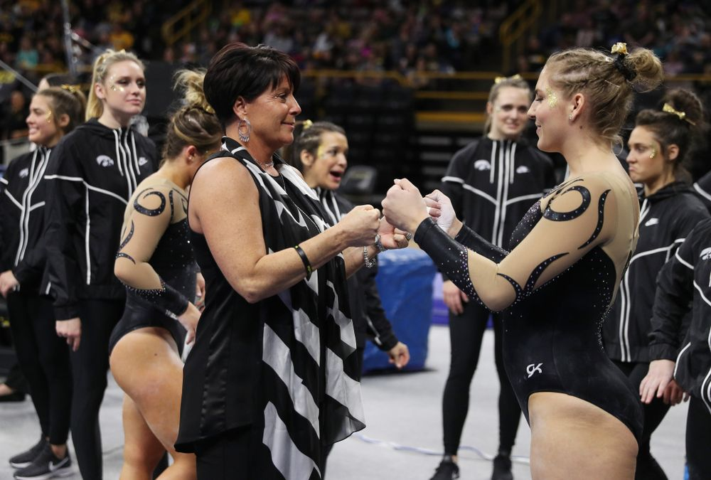 Iowa assistant coach Jennifer Green talks with Emma Hartzler before her routine on the beam during their meet against Southeast Missouri State Friday, January 11, 2019 at Carver-Hawkeye Arena. (Brian Ray/hawkeyesports.com)