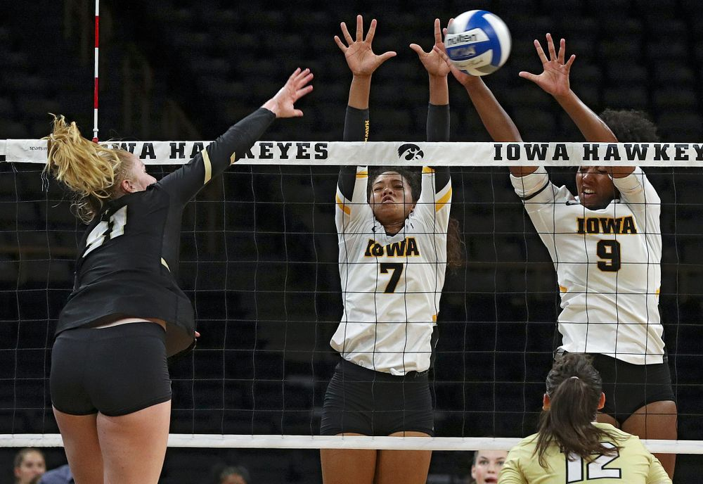 Iowa's Brie Orr (7) and Amiya Jones (9) get up for a block during the third set of their Big Ten/Pac-12 Challenge match against Colorado at Carver-Hawkeye Arena in Iowa City on Friday, Sep 6, 2019. (Stephen Mally/hawkeyesports.com)