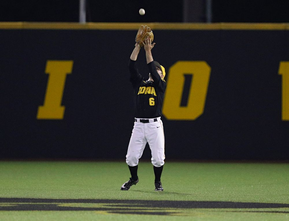Iowa Hawkeyes center fielder Justin Jenkins (6) pulls in a fly ball for an out during the ninth inning of their game against Western Illinois at Duane Banks Field in Iowa City on Wednesday, May. 1, 2019. (Stephen Mally/hawkeyesports.com)