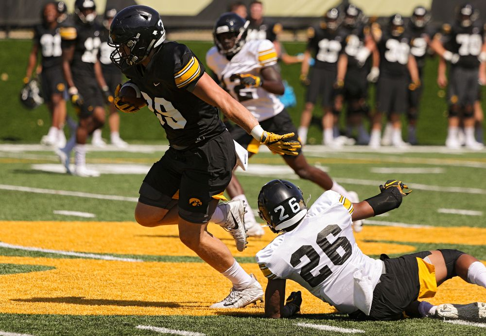 Iowa Hawkeyes tight end Nate Wieting (39) pulls away from defensive back Kaevon Merriweather (26) during Fall Camp Practice No. 7 at the Hansen Football Performance Center in Iowa City on Friday, Aug 9, 2019. (Stephen Mally/hawkeyesports.com)
