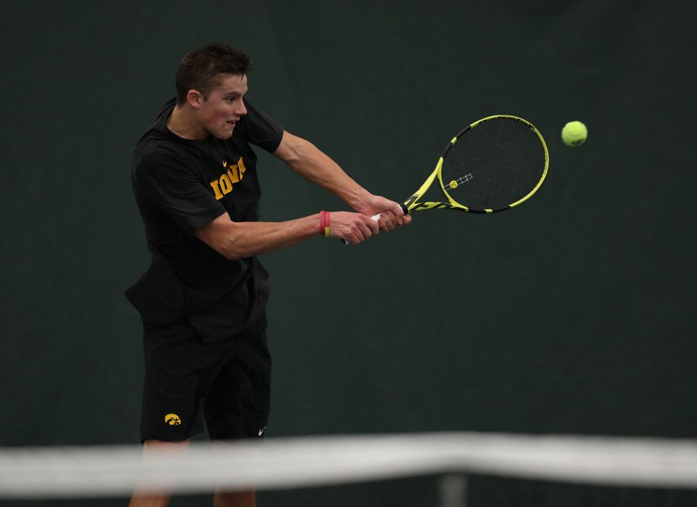 Joe Tyler against the Miami Hurricanes Friday, February 8, 2019 at the Hawkeye Tennis and Recreation Complex. (Brian Ray/hawkeyesports.com)