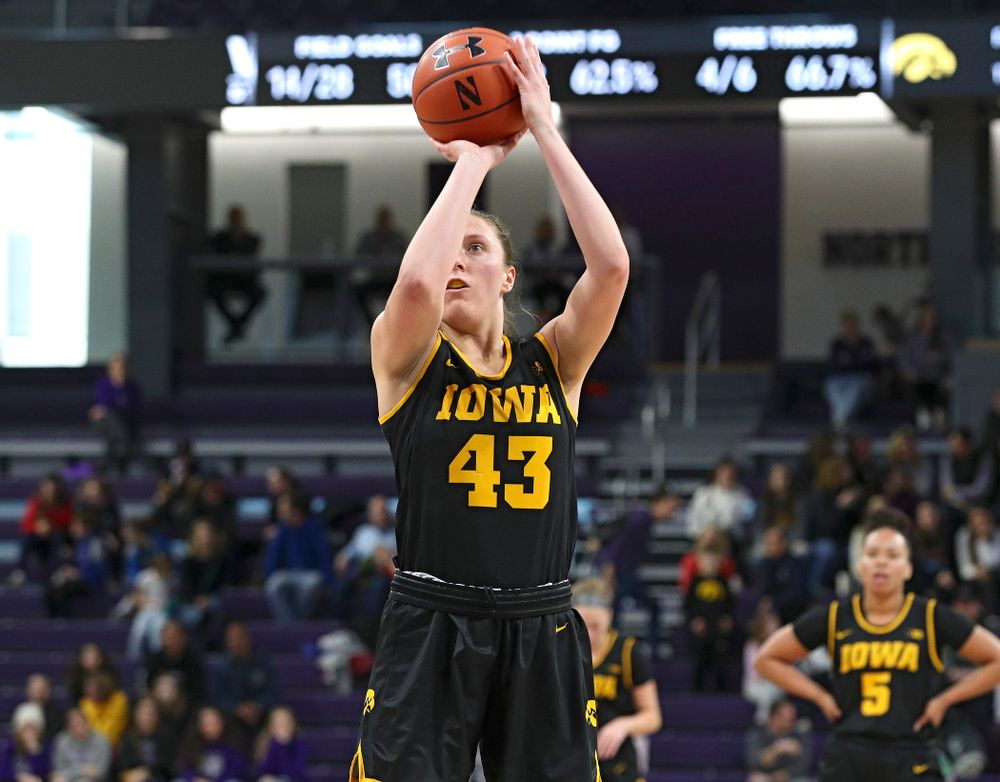 Iowa Hawkeyes forward Amanda Ollinger (43) makes a free throw during the third quarter of their game at Welsh-Ryan Arena in Evanston, Ill. on Sunday, January 5, 2020. (Stephen Mally/hawkeyesports.com)