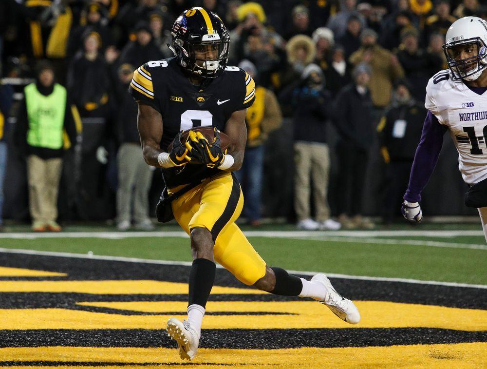 Iowa Hawkeyes wide receiver Ihmir Smith-Marsette (6) makes a touchdown reception during a game against Northwestern at Kinnick Stadium on November 10, 2018. (Tork Mason/hawkeyesports.com)