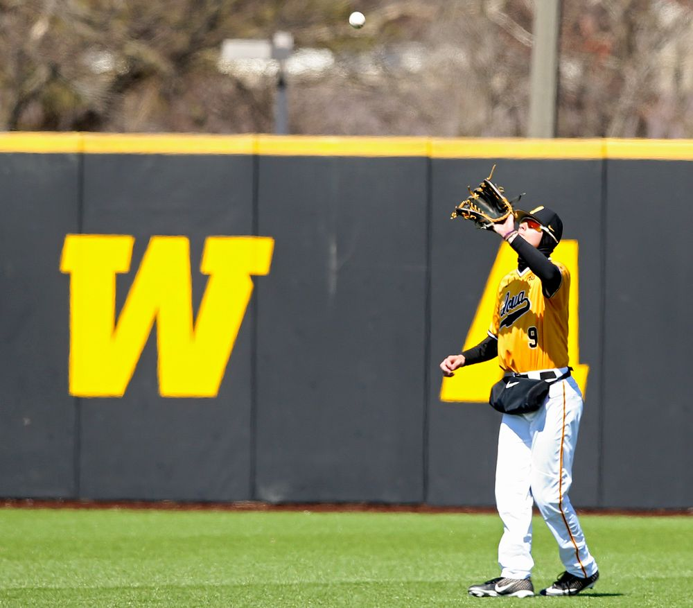 Iowa Hawkeyes center fielder Ben Norman (9) pulls in a fly ball for an out during the third inning against Illinois at Duane Banks Field in Iowa City on Sunday, Mar. 31, 2019. (Stephen Mally/hawkeyesports.com)