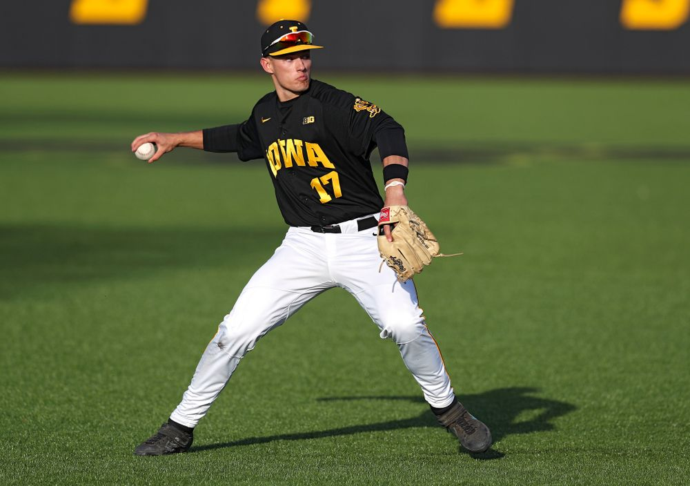 Iowa shortstop Dylan Nedved (17) throws to first for an out during the fifth inning of their college baseball game at Duane Banks Field in Iowa City on Tuesday, March 10, 2020. (Stephen Mally/hawkeyesports.com)