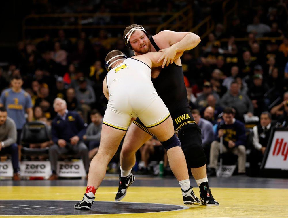 Iowa's Sam Stoll against Michigan's Adam Coon at heavyweight