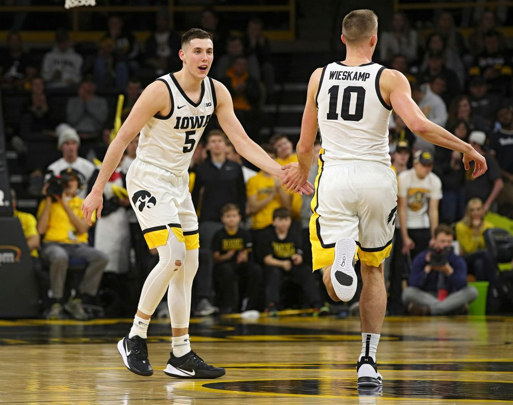 Iowa Hawkeyes guard CJ Fredrick (5) slaps hands wit guard Joe Wieskamp (10) after Wieskamp made a 3-pointer after an assist from Fredrick during the second half of their game at Carver-Hawkeye Arena in Iowa City on Friday, Nov 8, 2019. (Stephen Mally/hawkeyesports.com)