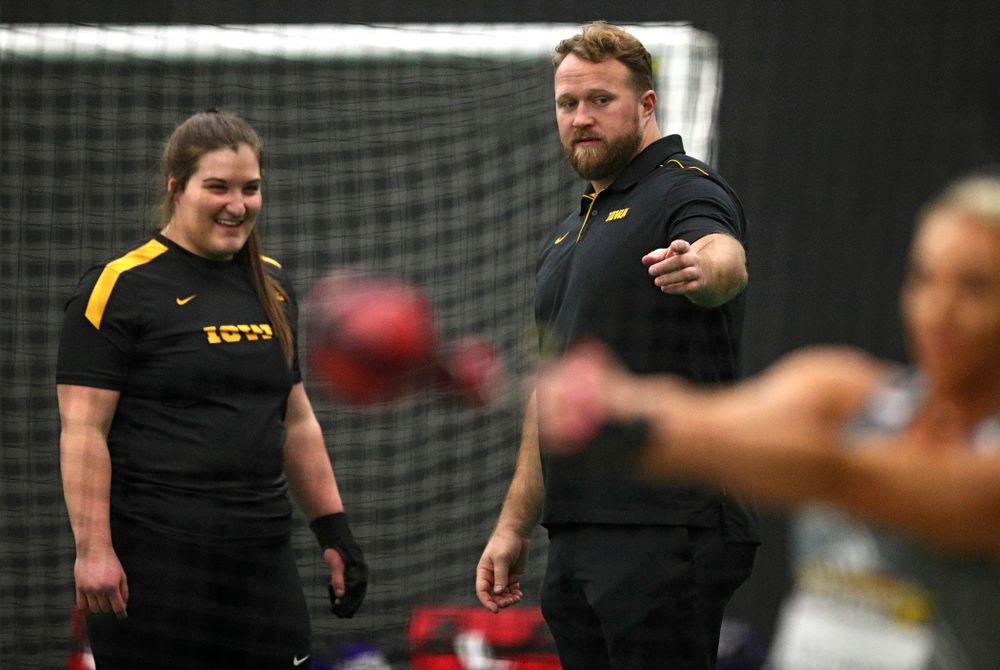 Iowa's Jamie Kofron (from left) talks with assistant coach Eric Werskey during the women's weight throw event during the Hawkeye Invitational at the Hawkeye Tennis and Recreation Complex in Iowa City on Friday, January 10, 2020. (Stephen Mally/hawkeyesports.com)