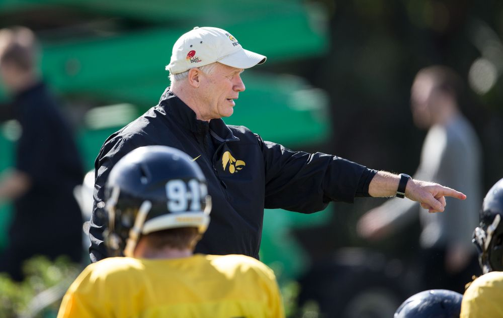 Iowa Hawkeyes defensive line coach Reese Morgan directs his players during the team's first Outback Bowl Practice Wednesday, Dec. 25, 2013 in Tampa. (Brian Ray/hawkeyesports.com)