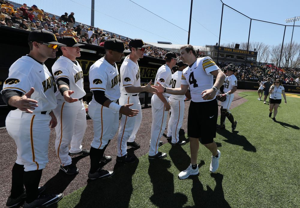Iowa Hawkeyes quarterback Nate Stanley (4) throws out a first pitch against the Nebraska Cornhuskers Saturday, April 20, 2019 at Duane Banks Field. (Brian Ray/hawkeyesports.com)