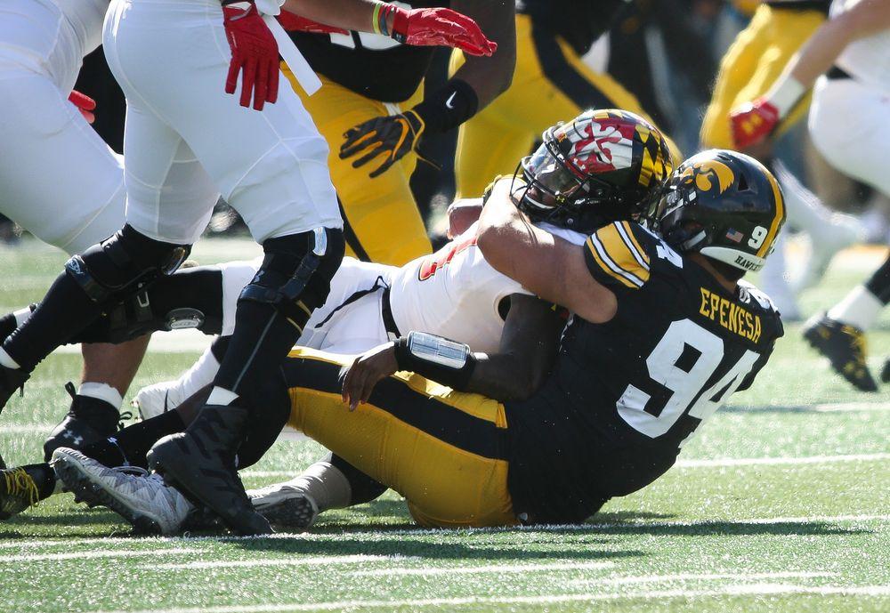 Iowa Hawkeyes defensive end A.J. Epenesa (94) sacks the quarterback during a game against Maryland at Kinnick Stadium on October 20, 2018. (Tork Mason/hawkeyesports.com)