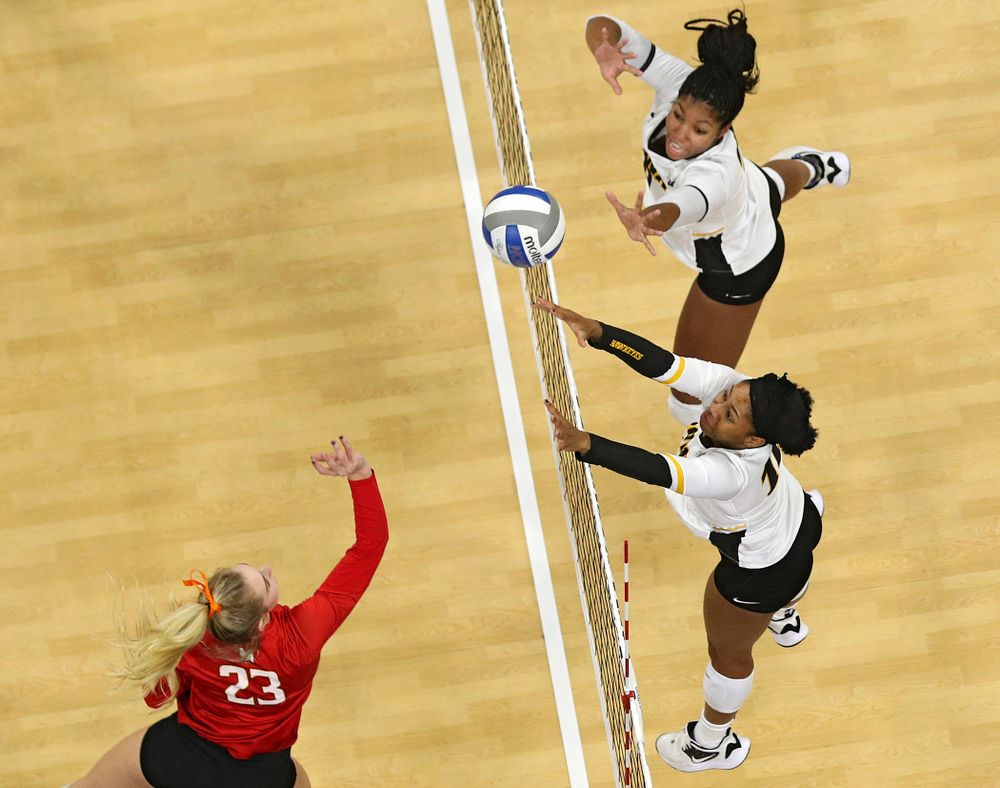 Iowa's Griere Hughes (bottom) and Amiya Jones (top) reach for the ball during the second set of their match at Carver-Hawkeye Arena in Iowa City on Saturday, Nov 30, 2019. (Stephen Mally/hawkeyesports.com)