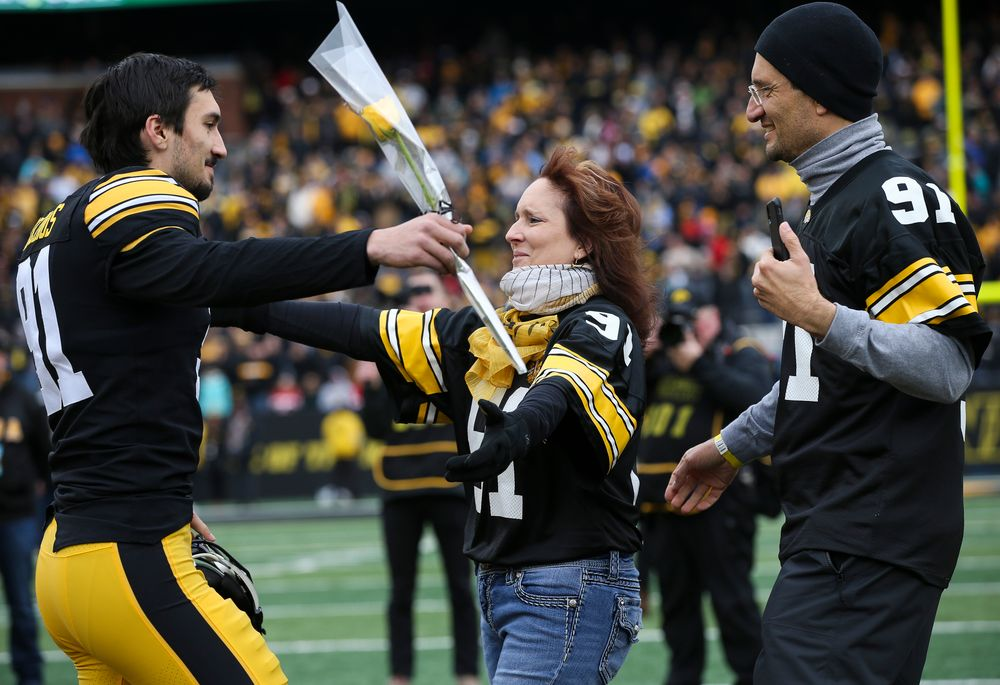 Iowa Hawkeyes placekicker Miguel Recinos (91) is greeted by his parents during Senior Day ceremonies before a game against Nebraska at Kinnick Stadium on November 23, 2018. (Tork Mason/hawkeyesports.com)
