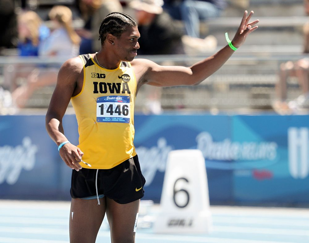 Iowa's Anthony Williams waves after running the men's 110 meter hurdles event during the second day of the Drake Relays at Drake Stadium in Des Moines on Friday, Apr. 26, 2019. (Stephen Mally/hawkeyesports.com)