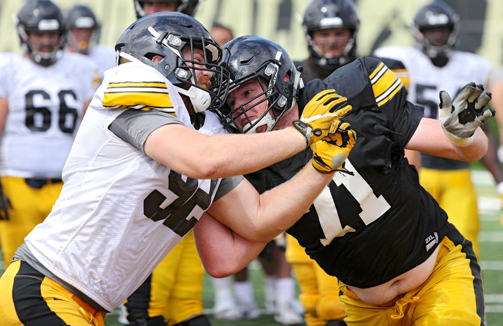 Iowa Hawkeyes defensive lineman John Waggoner (92) and offensive lineman Mark Kallenberger (71) run a drill during Fall Camp Practice No. 11 at the Hansen Football Performance Center in Iowa City on Wednesday, Aug 14, 2019. (Stephen Mally/hawkeyesports.com)