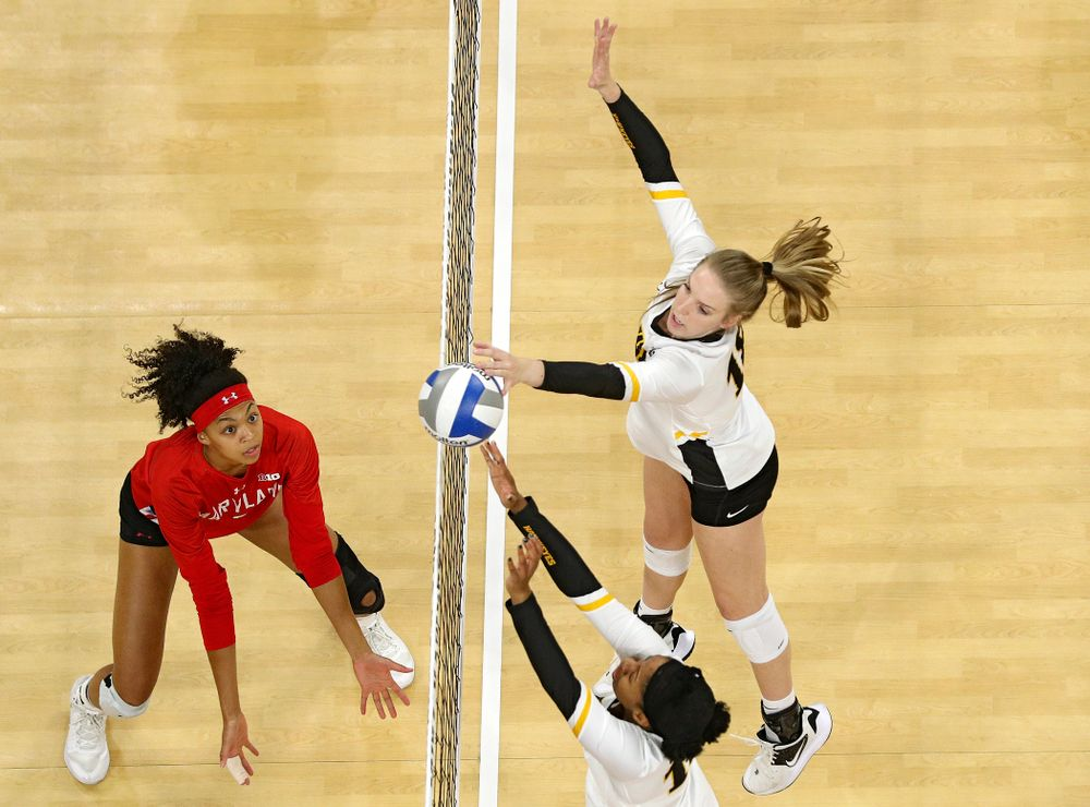 Iowa's Griere Hughes (bottom) and Hannah Clayton (18) block a shot during the second set of their match at Carver-Hawkeye Arena in Iowa City on Saturday, Nov 30, 2019. (Stephen Mally/hawkeyesports.com)