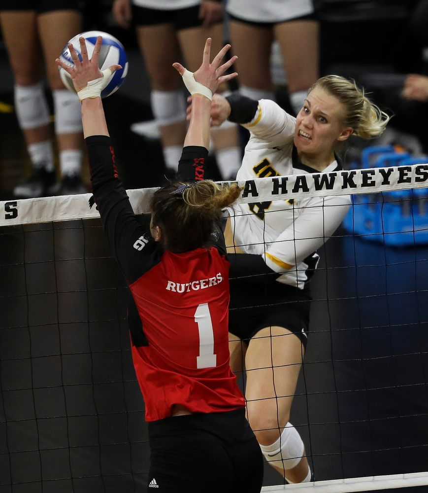 Iowa Hawkeyes right side hitter Reghan Coyle (8) spikes the ball during a match against Rutgers at Carver-Hawkeye Arena on November 2, 2018. (Tork Mason/hawkeyesports.com)