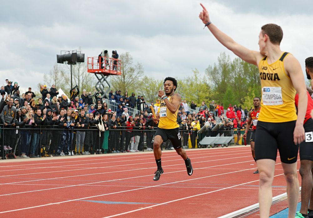 Iowa's Chris Thompson (right) starts to celebrate as May'yea Harris nears the finish line as they win the 1600 meter relay event on the third day of the Big Ten Outdoor Track and Field Championships at Francis X. Cretzmeyer Track in Iowa City on Sunday, May. 12, 2019. (Stephen Mally/hawkeyesports.com)