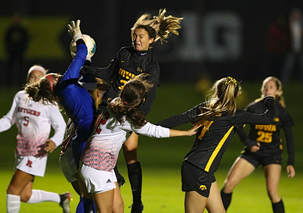 Iowa forward Emma Tokuyama (21) tries to head in a shot during the second half of their match at the Iowa Soccer Complex in Iowa City on Friday, Oct 11, 2019. (Stephen Mally/hawkeyesports.com)
