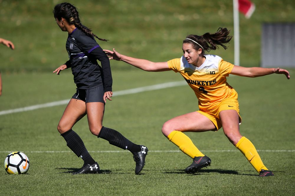 Iowa Hawkeyes forward Kaleigh Haus (4) defends during a game against Northwestern at the Iowa Soccer Complex on October 21, 2018. (Tork Mason/hawkeyesports.com)
