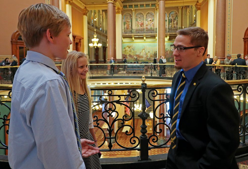 Iowa's Spencer Lee talks with young fans at the Iowa State Capitol Building on Tuesday, Apr. 9, 2019. (Stephen Mally/hawkeyesports.com)